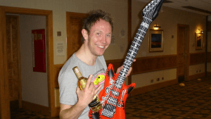 A happy winner of the air guitar competition completes this fun team building event