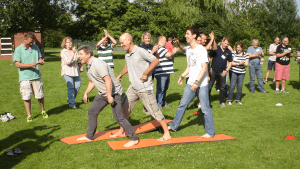"""Team tackling our """"Walk the plank"""" collaboratibve team building challenge"""